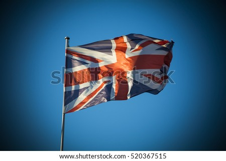 Union Jack in sunlight against clear blue sky