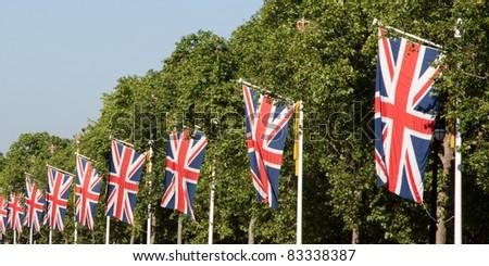 Union jacks on London street - stock photo