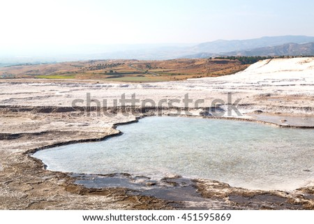 unique abstract in pamukkale turkey  asia the old calcium bath and travertine water - stock photo