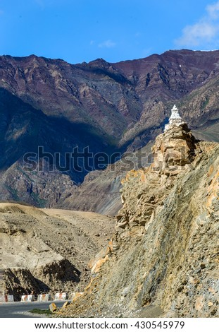 Unique ancient Buddhist stupa built stupa on the road near Basgo monastery - Tibet, Leh district, Western Ladakh, Himalayas, Jammu and Kashmir, Northern India - stock photo
