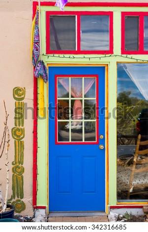Unique blue door with red trim in Madrid, NM - stock photo