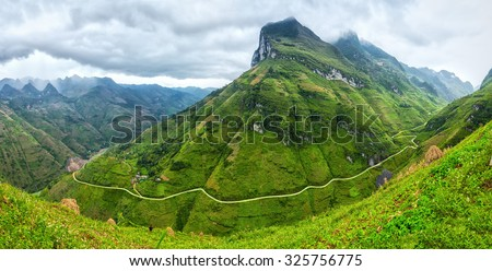 Unique bow Ma Pi Leng Pass, Ha Giang, Vietnam with clouds majestic mountains all year round attracting your soul to behold - stock photo