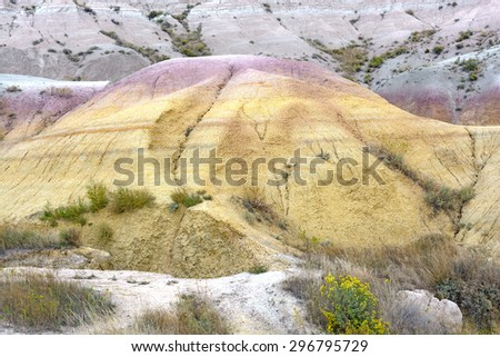 Unique Colors in a Badlands Hill in Badlands National Park in South Dakota - stock photo