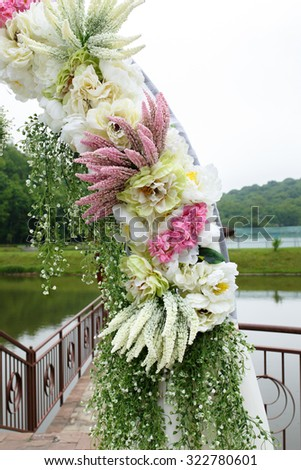 Unique floral wedding archway covered with flowers, plants and bouquets close-up - stock photo