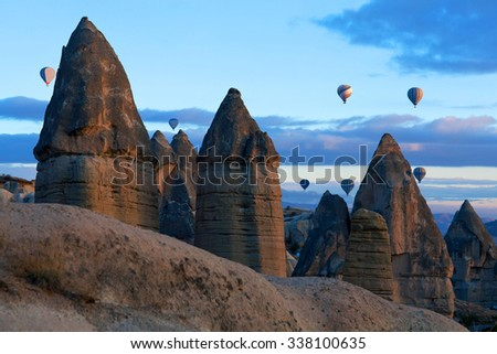 Unique geological formations in Cappadocia, Central Anatolia, Turkey. Cappadocian Region with its valley, canyon, hills located between the volcanic mountains Erciyes, Melendiz and Hasan. - stock photo