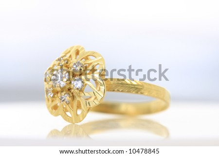 Unique handmade golden ring with rubies - white background - stock photo