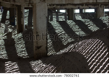 Unique image of light, shadows and textures as viewed from under a seaside boardwalk.
