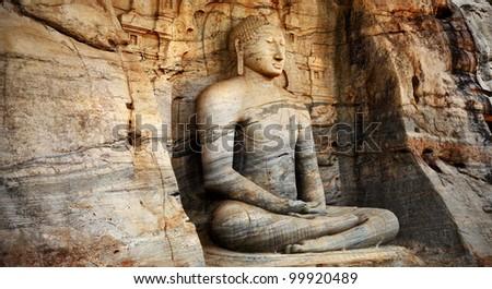 Unique monolith Buddha statue in Polonnaruwa temple - medieval capital of Ceylon,,UNESCO World Heritage Site - stock photo