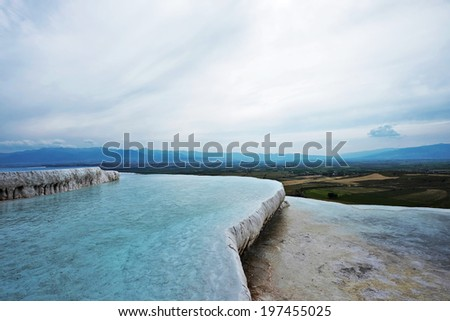 Unique nature landscapes: white travertine pools and terraces, Pamukkale, Turkey, unesco world heritage site - stock photo