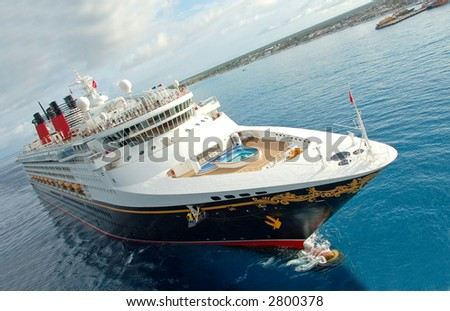 Unique perspective of cruise ship entering port - stock photo