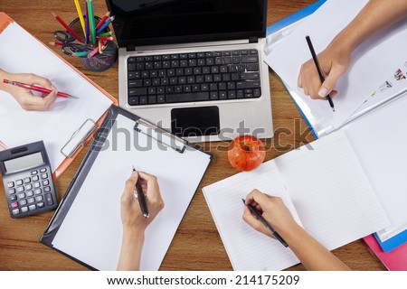 Unique Perspectives of hands of student group studying together on a desk - stock photo