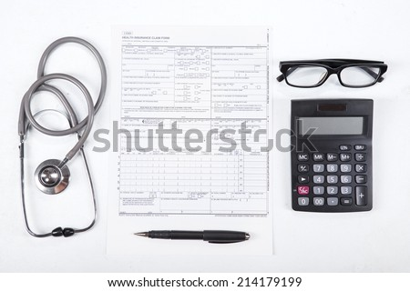 Unique Perspectives of Health insurance concept. Stethoscope, health form, pen, glasses, and calculator. - stock photo