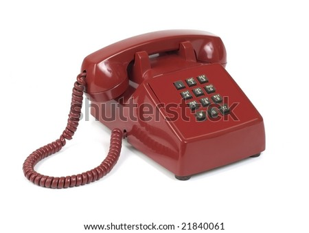 Unique push-button land-line red telephone. Shot with infinity white background - stock photo