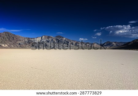 Unique Racetrack Playa in Death Valley National Park in California State. Horizontal Image Composition - stock photo