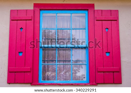 Unique red and blue gallery window in Madrid, NM - stock photo