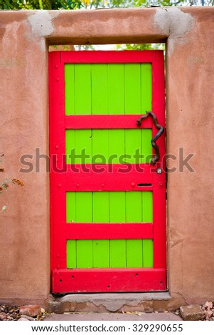 Unique red and green door  in Santa Fe, NM - stock photo