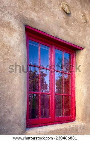 Unique red gallery window in Santa Fe, NM - stock photo
