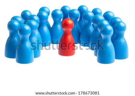 Unique red pawn centered in the middle of a large group. Concept for mobbing, autism, diversity, being different. Cutout, isolated on white. - stock photo