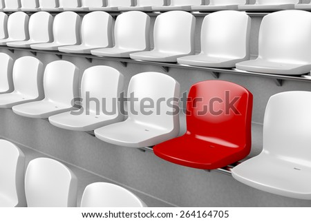 Unique red seat among white ones - stock photo