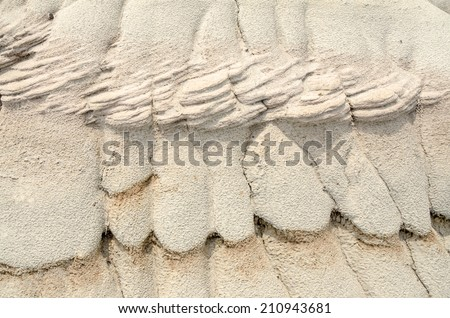 Unique shaped sedimentary soil caused by water erosion - stock photo