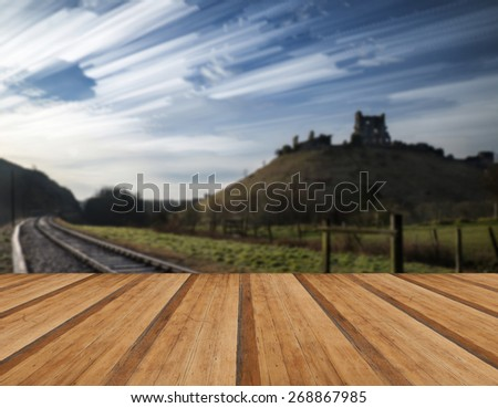 Unique time lapse stack landscape of medieval castle and railway tracks with wooden planks floor - stock photo