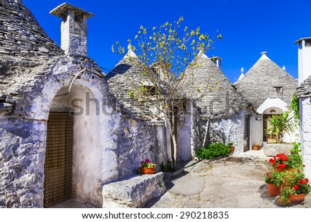 Unique Trulli houses with conical roofs in Alberobello, Italy, P - stock photo