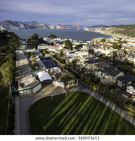Unique view from the treetops over San Francisco's Lincoln Park looking over Presidio Heights, Baker Beach, and towards the Golden Gate Bridge - stock photo
