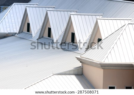 Unique white triangular shaped aluminum metal roof designed for maximum rain repulsion and heat reflection