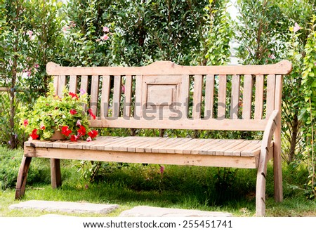 Uniquely designed wooden bench - stock photo