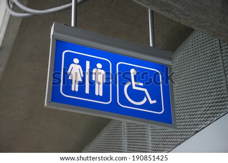 Unisex restroom, toilet, WC. at the airport - stock photo