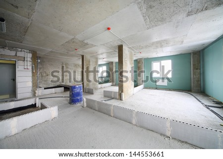 Unit in building under construction without finishing and with markings of walls. - stock photo