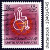 UNITED ARAB EMIRATES - CIRCA 1981: a stamp printed in the UAE shows Man in Wheelchair, International Year of the Disabled, circa 1981 - stock photo