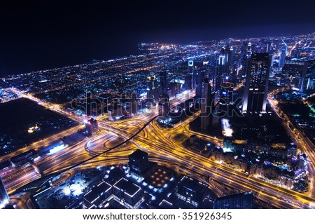 United Arab Emirates, Dubai, 09/02/2014, downtown dubai futuristic city neon lights and sheik zayed road shot from the worlds tallest tower burj khalifa - stock photo