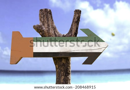 United Arab Emirates wooden sign with a river on background  - stock photo