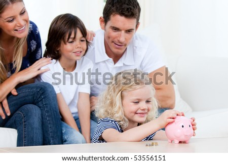 United family playing together at home - stock photo
