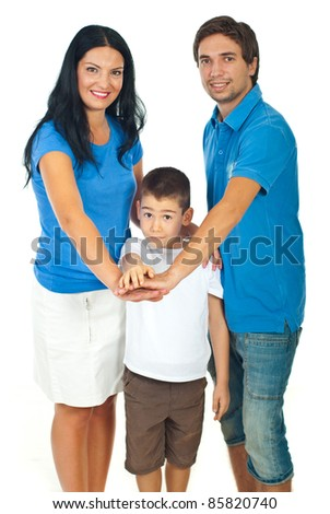 United family with their hands on top each other isolated on white background,selective focus on surprised boy - stock photo