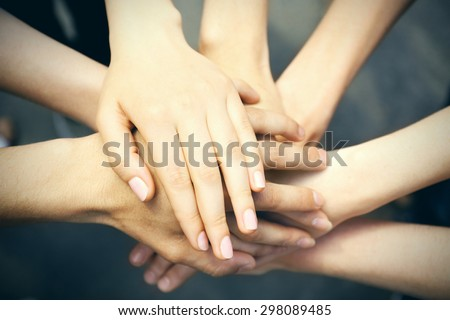 United hands close-up - stock photo