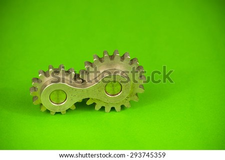 United joint machinery element of two cylindrical cogwheel fragments spinning together as system of connected parts, symbolizing thinking concept and mechanical approach to kinetic movement problems - stock photo