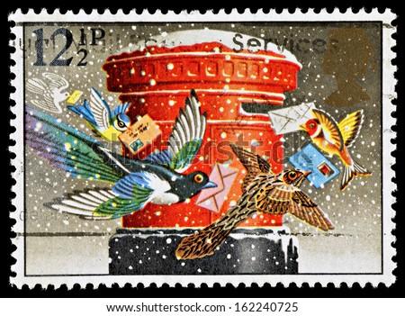 UNITED KINGDOM - CIRCA 1983: A British Used Christmas Postage Stamp showing Christmas Post Box, circa 1983 - stock photo
