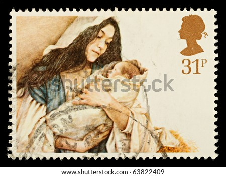 UNITED KINGDOM - CIRCA 1984: A British Used Christmas Postage Stamp showing Mary and Baby Jesus, circa 1984 - stock photo
