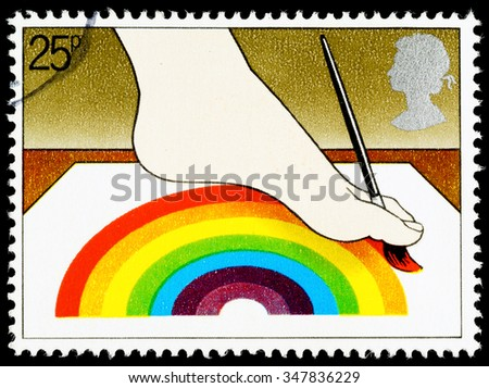 UNITED KINGDOM - CIRCA 1981: A British Used Postage Stamp Commemorating The Year of the Disabled Showing Disabled Artist Painting with Foot - stock photo