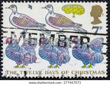 UNITED KINGDOM - CIRCA 1977: A post stamp printed in the Great Britain shows the Twelve Days of Christmas, circa 1977 - stock photo