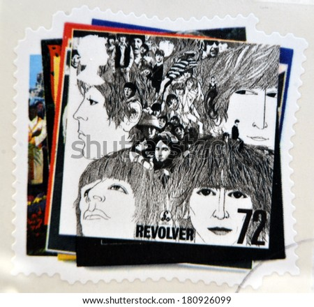 UNITED KINGDOM - CIRCA 2007: a postage stamp printed in Great Britain showing an image of The Beatles, Revolver album cover, circa 2007.  - stock photo