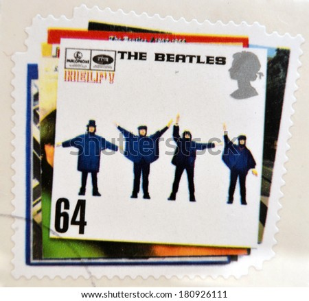 UNITED KINGDOM - CIRCA 2007: a postage stamp printed in Great Britain showing an image of The Beatles, Help album cover, circa 2007.  - stock photo