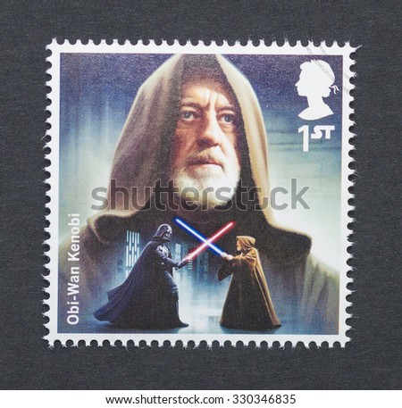 UNITED KINGDOM - CIRCA 2015: a postage stamp printed in United Kingdom commemorative of Star Wars movie with Obi-Wan Kenobi character, circa 2015.  - stock photo
