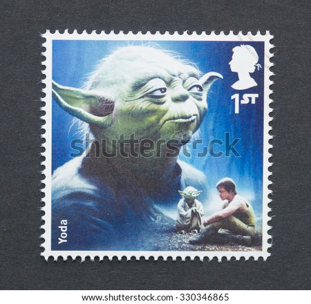 UNITED KINGDOM - CIRCA 2015: a postage stamp printed in United Kingdom commemorative of Star Wars movie with Yoda character, circa 2015.  - stock photo