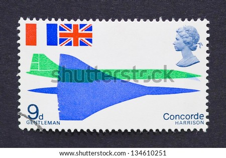 UNITED KINGDOM - CIRCA 1969: a postage stamp printed in United Kingdom showing an image of Concorde, circa 1969. - stock photo