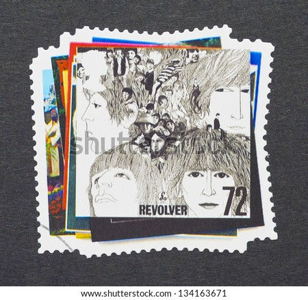 UNITED KINGDOM - CIRCA 2007: a postage stamps printed in United Kingdom showing an image of The Beatles, Revolver album cover, circa 2007.