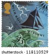 UNITED KINGDOM - CIRCA 2001: a stamp from the United Kingdom shows image of a barometer forecasting rain/stormy weather, circa 2001 - stock photo