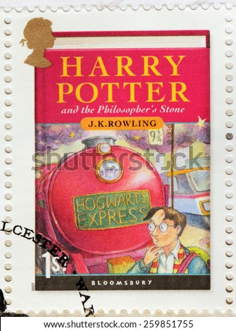 UNITED KINGDOM - CIRCA 2007: A stamp printed by GREAT BRITAIN shows image of the cover of Harry Potter and the Philosopher's Stone novel by Joanne (Jo) Rowling, pen names J. K. Rowling, circa 2007. - stock photo
